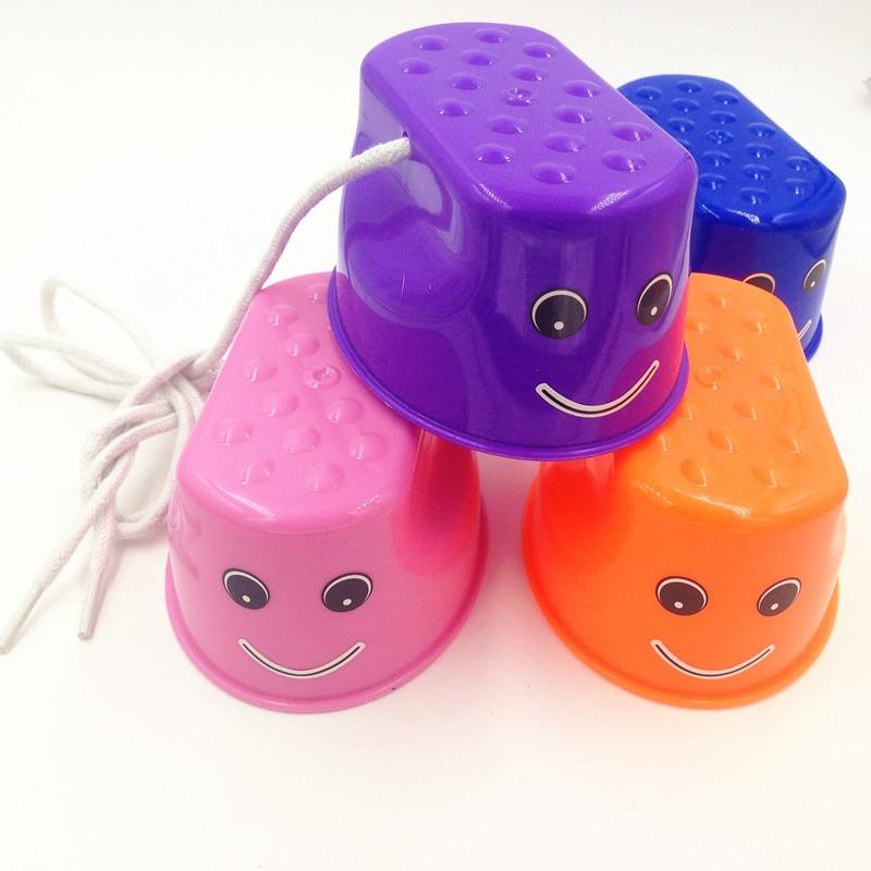 Høj kvalitet 7 farver Plastic Walkers stilt jumpere Sko Udendørs sjov Walking Jumping Balance Sport Træning Børn Legetøj Smil