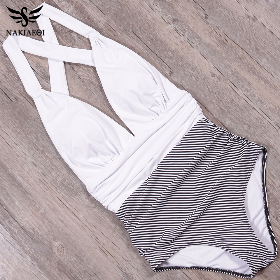 Foto from the top of white color new one piece swimsuit for beach. Swimming backless v-neck for women