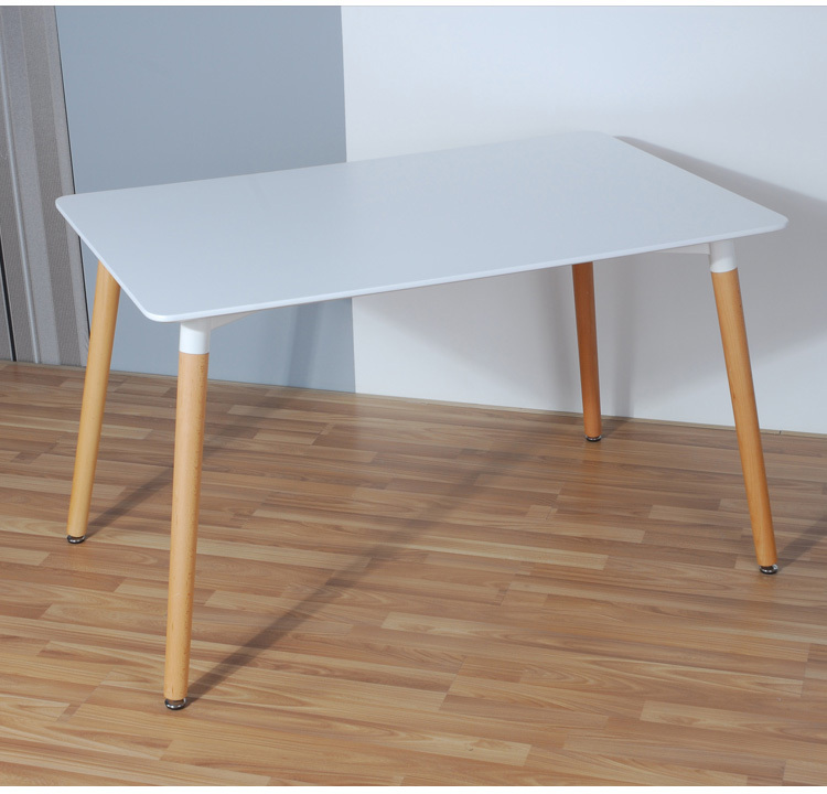 Simple fashion table. Desktop is MDF fine processing. The leg of the table is made of solid beech.Black and white can be chosen. simple fashion table desktop is mdf fine processing the leg of the table is made of solid beech black and white can be chosen
