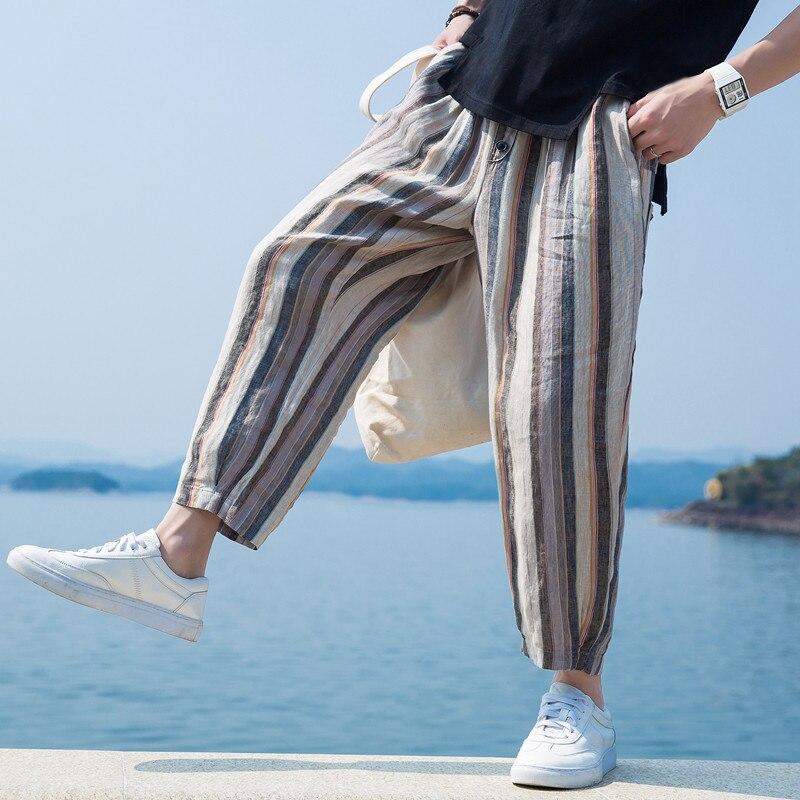 Otoño corto hombres Baggy Pantalones anchos sueltos raya impresión caído de  la cintura elástico Harem HipHop d0a1c0e63438