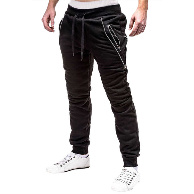 2019 новые мужские штаны для бега Однотонная повседневная обувь свободные Спортивные леггинсы обтягивающее фитнес, тренажерный зал Джоггеры мужские футбольные тренировочные штаны Штаны