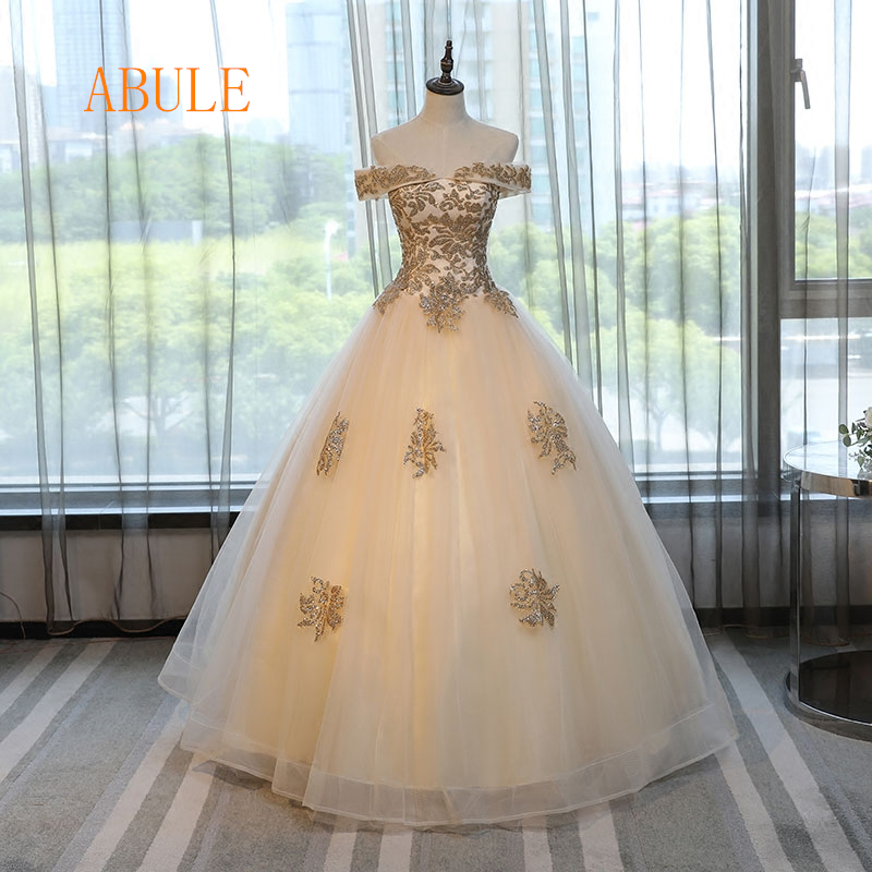 8f5c6e79b30 abule Quinceanera Dresses 2018 srtapless lace up Gold ball gown prom dress  Debutante Gown 15 Years