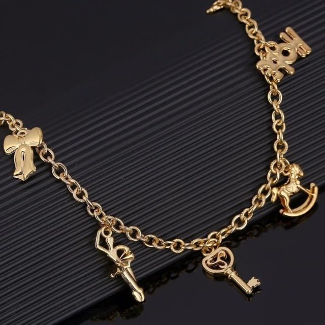 59148a03c35b Caballo mecedora pulsera para las mujeres chica oro color brazalete  Amuletos esperanza mano clave pulsera cadena