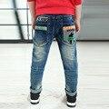 Мальчики с джинсов известная марка 2015 тощий печать брюки насыщенный синий мода , шорты больший размер прекрасные мальчики длинные джинсы