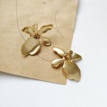 Creative new metal alloy irregular flower ear studs European and American fashion personality Woman Earrings