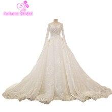Robe de mariée luxe à manches longue tra ...