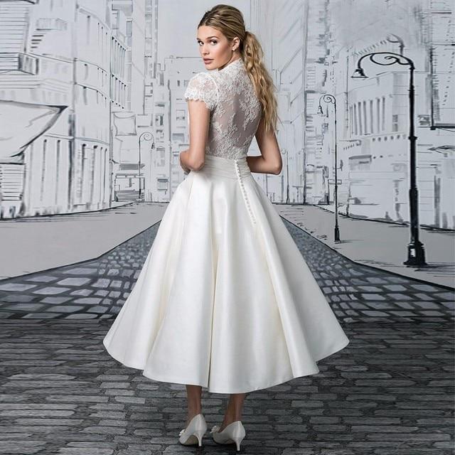 f5fe6ddec أبيض قصير ألف خط فستان الزفاف الخامس عنق أنيقة قصيرة الأكمام الشاي طول  العودة أثواب الزفاف
