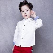 14ee279055dc 2018 nuevo Niños blanco Camisas primavera otoño azul casual Europa y  América camisa de manga larga rayas bebé de la manera de lo.