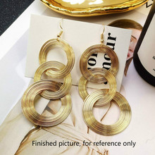 ФОТО japan and south korea personality joker europe retro diy exaggerated metal geometric circle long pendant earrings accessories