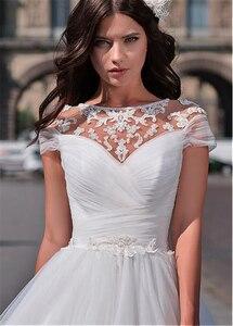 Image 4 - Tuyệt vời Voan Ngọc Viền Cổ Chữ A Váy áo Với Ren Appliques Ngắn Tay Cô Dâu Váy ĐầM Ren