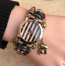 2015 nuevos relojes estudiante de moda femenina modelos auténticos hechos a mano pulsera de cuero genuino reloj Sra. ocio