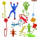 1 piece 9cm*3cm Silica gel robot Climbing Spider-Man sticky Spiderma Superman Climbing on glass for kids fuuny toy boy 7 colors