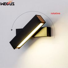 The new creative rotation led wall lamp, modern simple bedroom bedside lamp