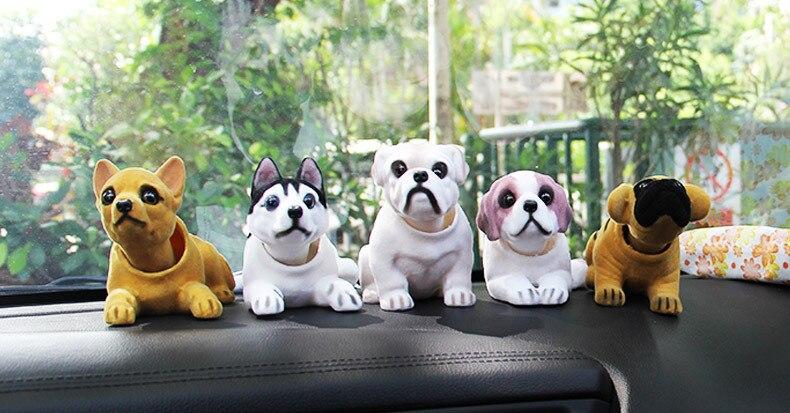 https://ae01.alicdn.com/kf/HTB1DrwEIFXXXXbVXVXXq6xXFXXXk/Cute-Bobblehead-Dog-Doll-Car-Ornament-Car-Nodding-Dog-Shakes-His-Head-Shaking-Dog-Toys-For.jpg