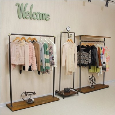 iron clothing rack floor wood hangers child to do the old vintage clothing store shelf garment. Black Bedroom Furniture Sets. Home Design Ideas