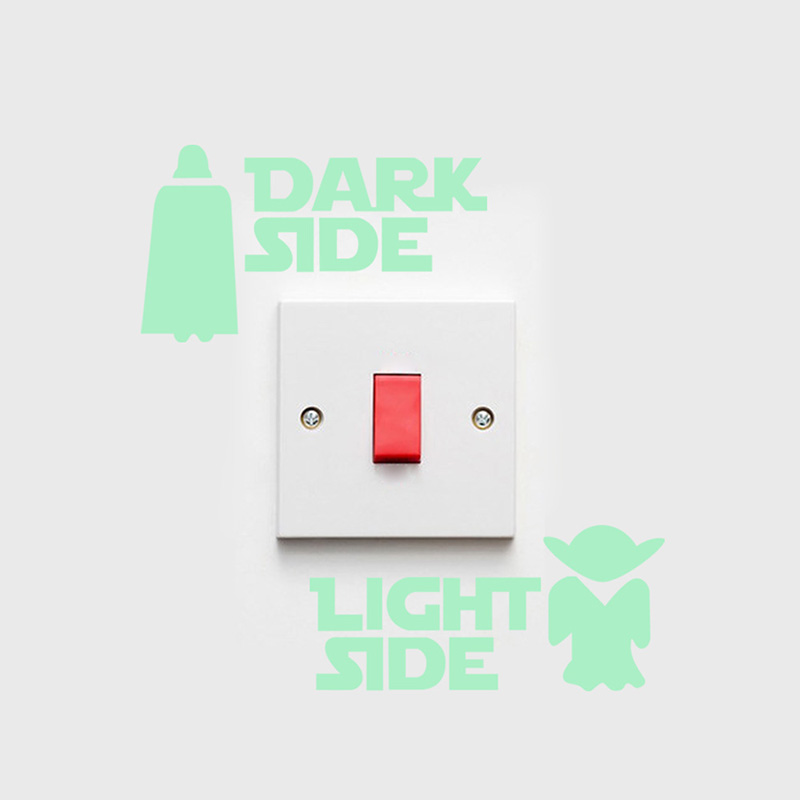 another version of the dark side and light side star wars sticker with vader and yoda on a white wall
