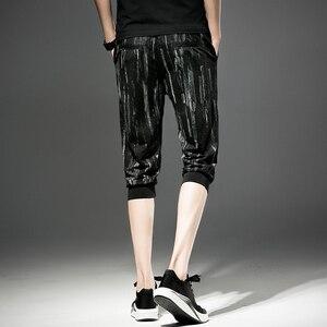 Image 2 - شحن مجاني جديد الذكور الرجال رجل الأزياء اقتصاص السراويل الصيف كبيرة الحجم الكورية أسود فضفاض رقيقة العجل طول السراويل