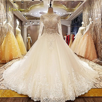 Loverxu Robe De Mariee Sexy Illusion Long Sleeve Wedding Dresses 2018 Appliques Beaded Royal Train A Line Bridal Gown Plus Size
