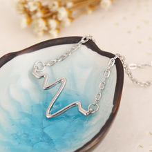 Heartbeat Statement Necklaces