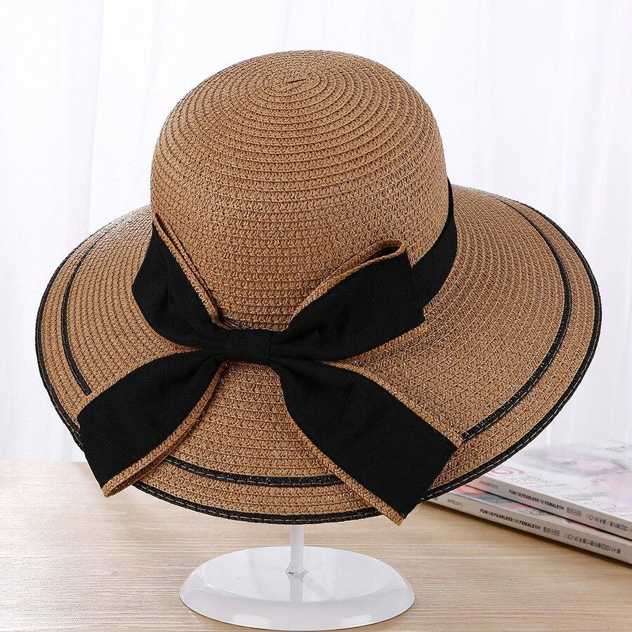 Sun Cappello Grande Fiocco Nero Cappelli Estivi Per Le Donne Pieghevoli  Spiaggia Della paglia Panama Cappello Visiera Tesa Larga Femme Femmina 2018  nuovo ... 9cc99f1ac7b2
