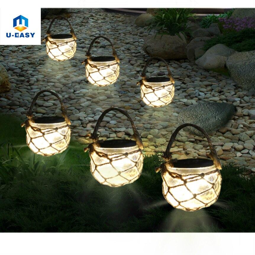 ueasy solar powered outdoor glass garden decking lights hanging lantern with rope warm white - Solar Powered Lanterns