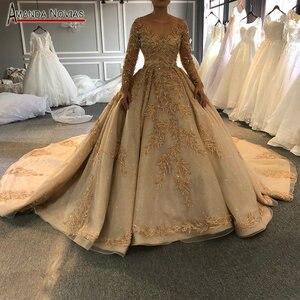 Image 1 - 2020 goldenen voll perlen hochzeit kleid funkelnden luxus lange zug brautkleid ohne schleier