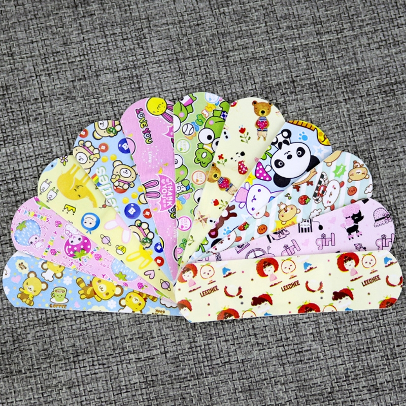 Купить с кэшбэком 100Pcs Children Dreathable Waterproof Wound Patch Cartoon Waterproof Bandage Band-Aid Hemostatic Adhesive For Kids Children