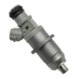 Image 2 - 4 יח\חבילה דלק מזרק זרבובית E7T05074 (M 1.81) DIM1070G E7T05074 עבור מיצובישי פאג רו III 3.5GDI