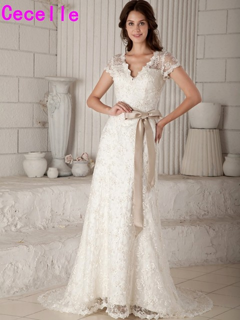 288d7be72700 2019 Real Designer Modest Lace A-line Wedding Dresses Bridal Gowns With Cap  Sleeves Champagne Sashes V Neck Wedding Gowns