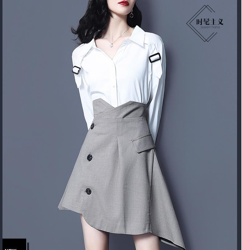 A two-piece a-line skirt with a high-waisted white shirt and slim figure