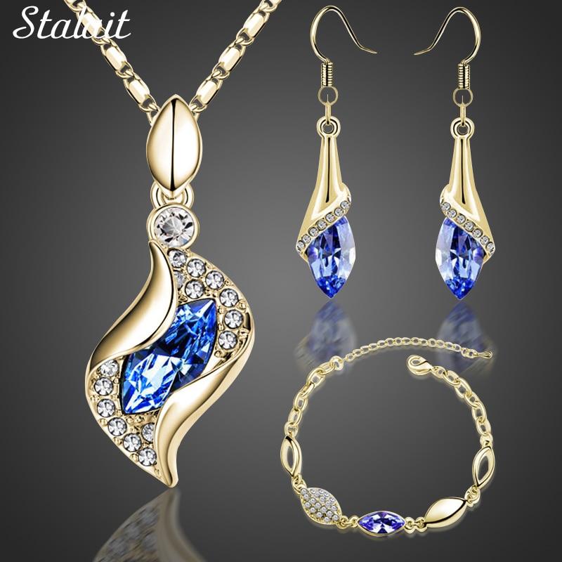 Sistemas nupciales de la joyería de la manera Ojo del caballo Color del oro Cristal austriaco Colgante Collar Pendientes Sistemas de la joyería de la pulsera