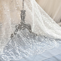 Delicate Ivory African Net Lace Fabric Sequins Latest Waves Fringe French Lace Fabric For Wedding 1yard