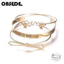 acdb6b008aed 3 unids set moda Simple Color oro y plata las mujeres pulseras arco nudo  ser valiente letras abierto brazalete brazaletes de joy.