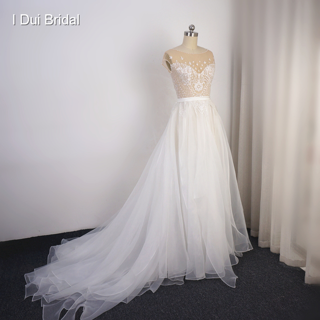 Cap Sleeve Sparkle Wedding Dress with Organza Ruffles Illusion Neckline Shinny Bridal Gown