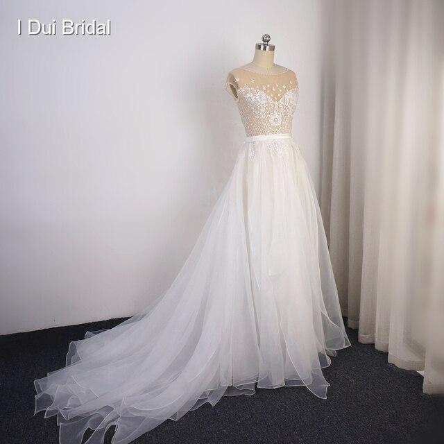 Cap Sleeve Sparkle düğün elbisesi organze Ruffles Illusion boyun çizgisi parlak gelin kıyafeti