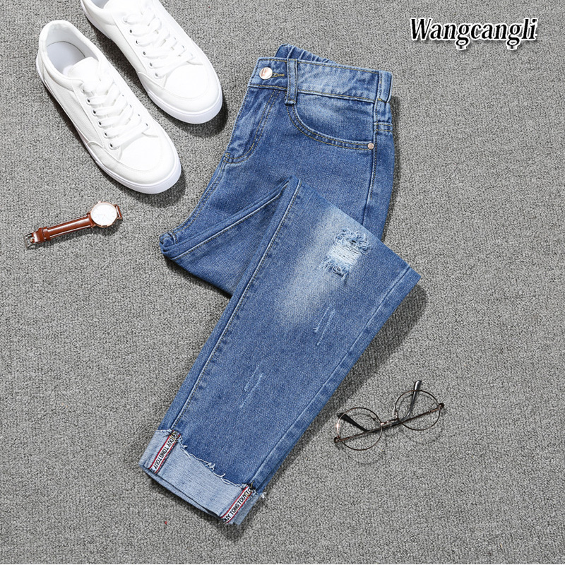 HTB1E3EMgQKWBuNjy1zjq6AOypXai Fashion Large size women's denim nine pants 2018 spring and summer high waist hole 5XL Blue women's elastic feet pants 015#