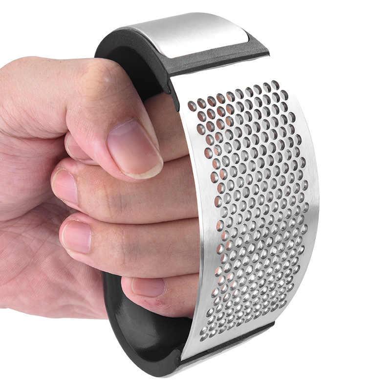 1pcs สแตนเลสสตีลกระเทียมกดด้วยตนเองกระเทียมสับกระเทียมเครื่องมือ Curve ผลไม้ผักเครื่องมือครัว Gadgets