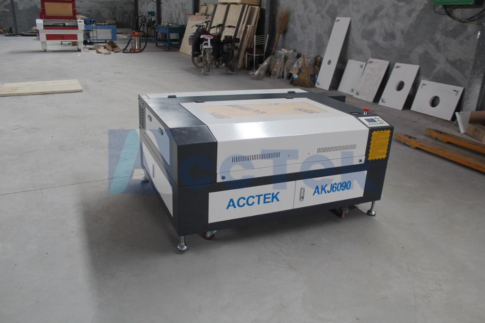Low cost cnc laser stone/acrylic/wood engraving machine 60W 6090 mini laser engraverLow cost cnc laser stone/acrylic/wood engraving machine 60W 6090 mini laser engraver
