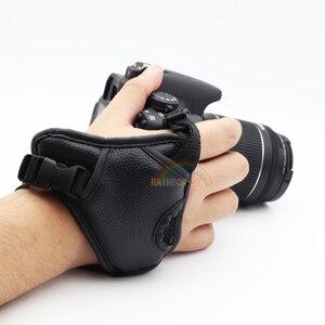 Image 1 - جلد طبيعي المعصم اليد حزام أسود جلد كاميرا اليد حزام قبضة عالية الجودة الثلاثي SLR/DSLR كاميرا جلدية حزام لينة