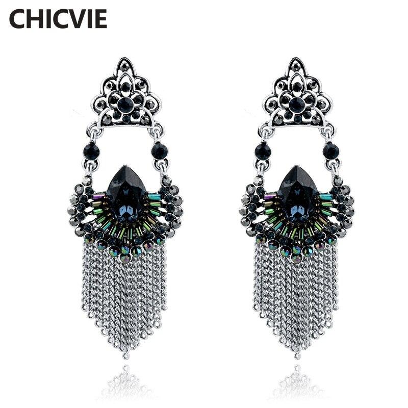 d89eafccbb1c Chicvie tendencia ahora declaración Pendientes de gota para las mujeres  plata color rhinestone borla metal marca joyería regalos ser160108
