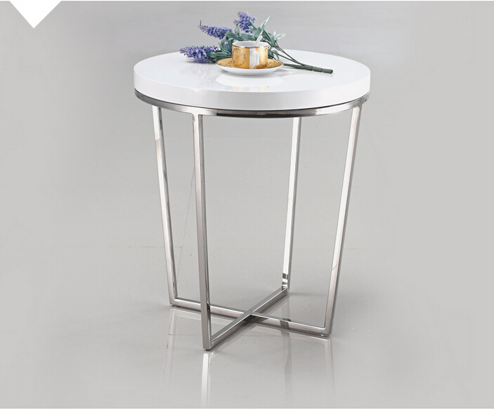 A few modern side. Small round tea table. The piano lacquer that bake the sofa side table white  coffee table