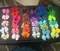 Hot 40 unids 40 Colores Grosgrain Cinta Arcos Del Pelo CON Los Clips de Las Muchachas Del Bebé Boutique PinWheel HairBows Niños Pinza de Pelo Del Pelo accesorios