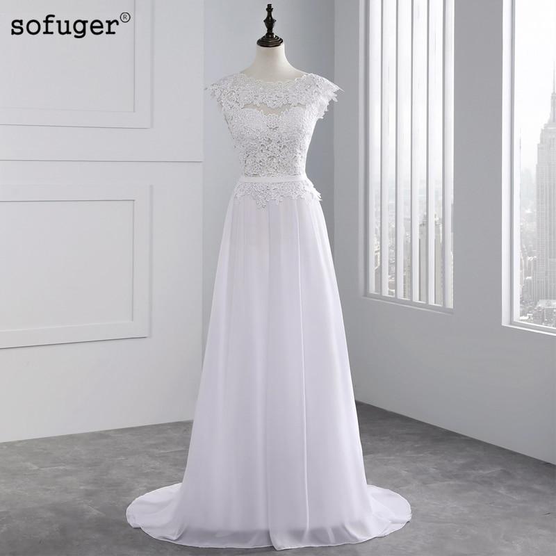 d5e40eea0d Egyedi hímzett csipke esküvői ruha 2019 Lenyűgöző olcsó strand ...