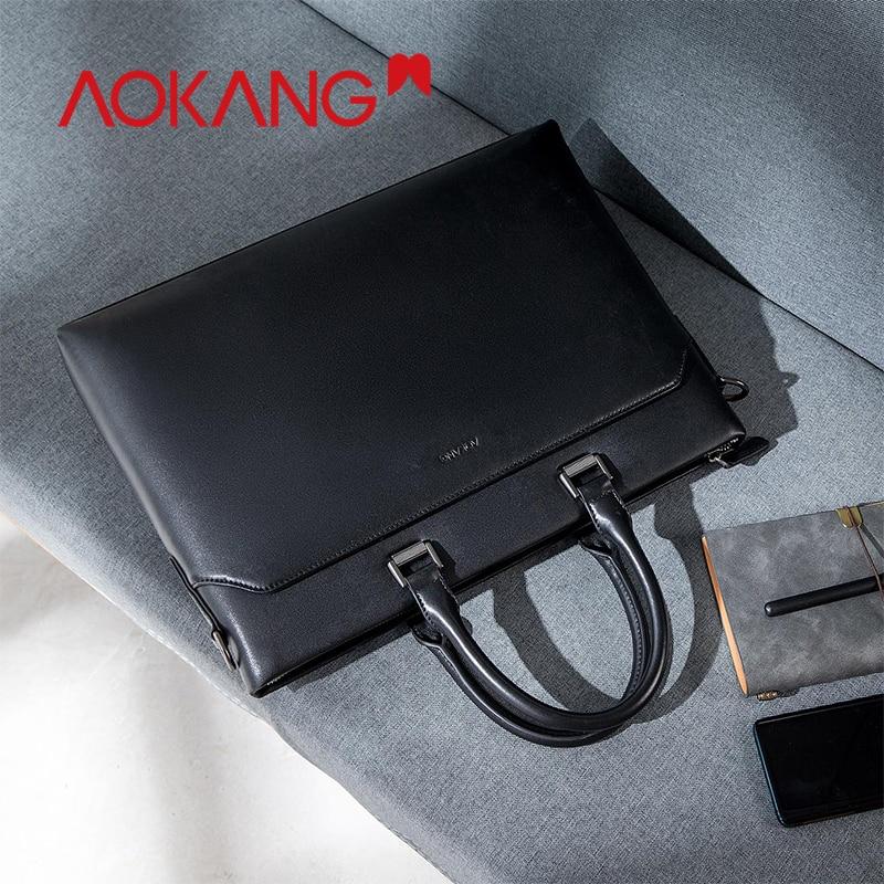 Aokang 2019 ผู้ชายธุรกิจกระเป๋าเอกสารสีดำของแท้หนังผู้ชายกระเป๋าถือชาย sacoche Homme จัดส่งฟรี-ใน กระเป๋าเอกสาร จาก สัมภาระและกระเป๋า บน   1
