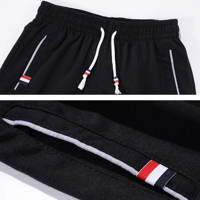 DIMUSI Mens Joggers Casual Pants Fitness Men Sportswear Tracksuit Bottoms Skinny Sweatpants Trousers Gyms Jogger Track Pants 6XL 5
