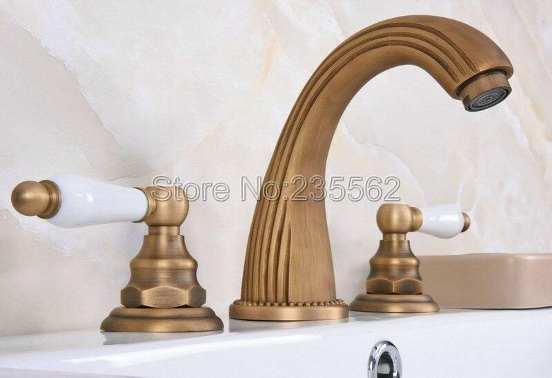 Antique Brass 3 Holes Bathroom Sink Mixer Tap Widespread Basin Faucet Dual Handle Bathroom Basin Faucet  lan070Antique Brass 3 Holes Bathroom Sink Mixer Tap Widespread Basin Faucet Dual Handle Bathroom Basin Faucet  lan070