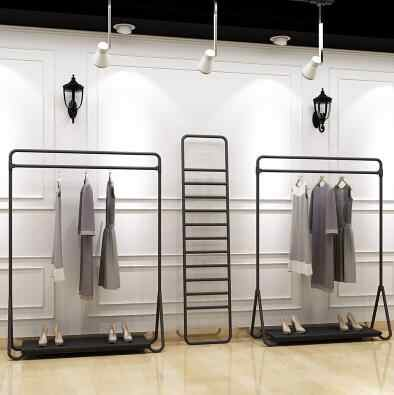 clothing store hanging clothes rack clothes rack floor mounted hangers wrought iron island frame black iron shelf