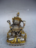 Crafts statue Decorative old handmade silver and gold sitting Buddha in Tibet