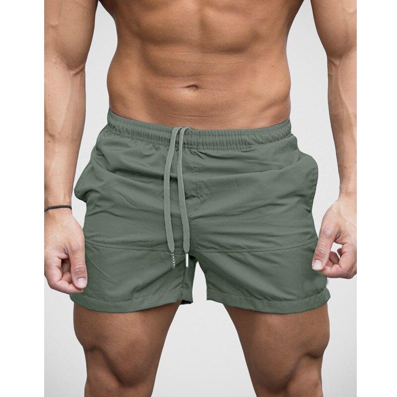Homens elegantes Calções Calções de Moda Corredores Sweatpants Masculina Hombre Academias de Musculação Workouts Com Cordão Praia BoardShorts