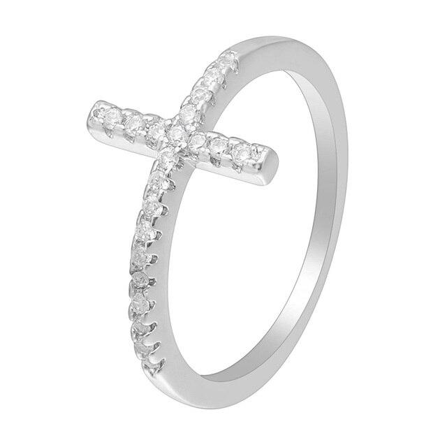 Фото трендовые кольца с боковым крестом и серебряным покрытием модные цена